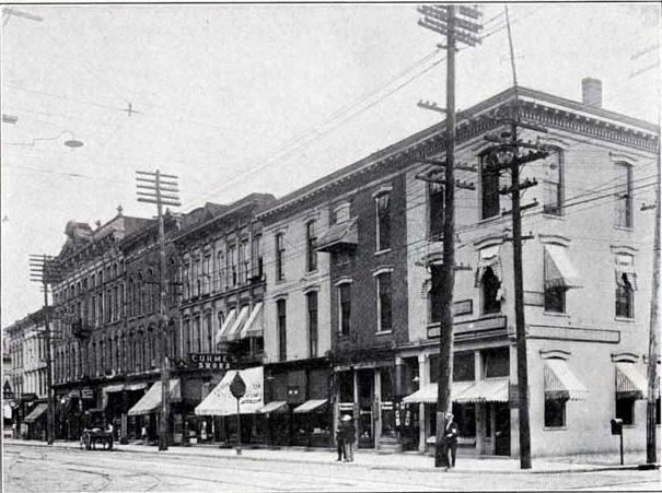 In 1906, 726 Main, Richmond, Indiana is the light colored building in center of photo.